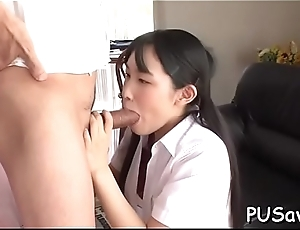 Japanese pussy gets finger drilled as she licks large cock