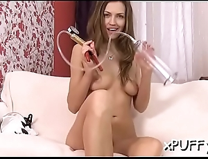 Fascinating darling triggering her lusty snatch with wild dildo play