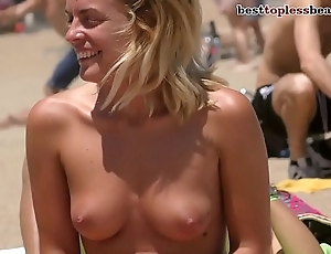 Dazzling blonde Topless on the Strand