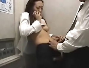 Japanese Lady in Elevator 2