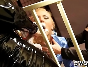 Kinky whore rides a bottle with her bald cunt at gloryhole