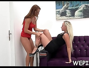One babe is pissing while the stand-in one is licking her vagina
