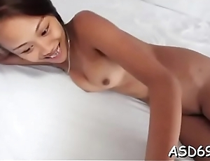 Cute oriental sex doll gets her face hole fucked by a horny guy