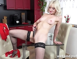 Sexy tow-haired in stockings pleases herself down dildo