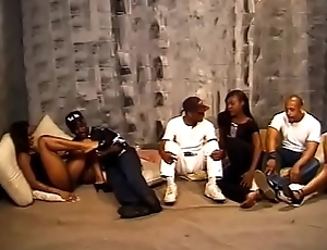 Three hot ebony sluts get their cunts licked by several Negro studs