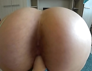 A girlfriend fucks a bbw in a hairy pussy, plump jumps on a dildo and shakes butt in panties, lesbians POV.
