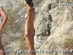 Asian teen naked primarily the beach fully nude in public showing her smooth pussy!