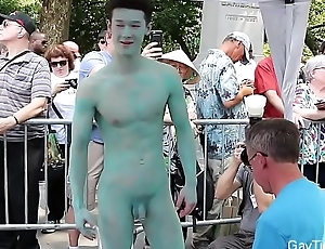 Naked Asian Lad'_s body is painted all over public